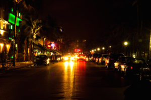 Ocean Drive scene at night lights, South Beach Florida, USA.